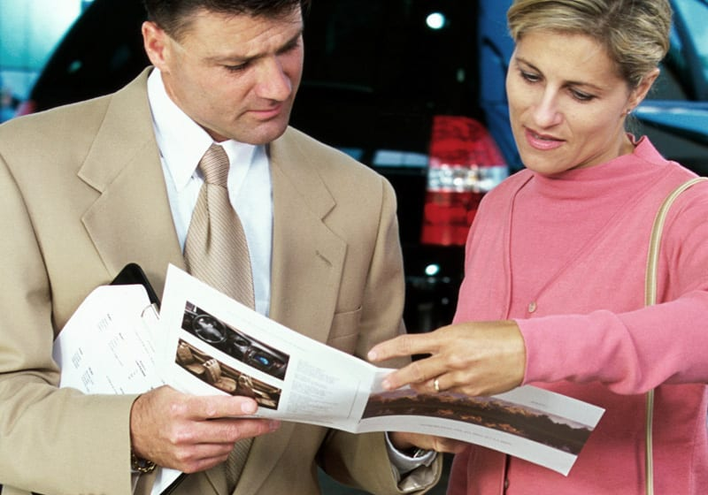 Couple looking at a printed leaflet